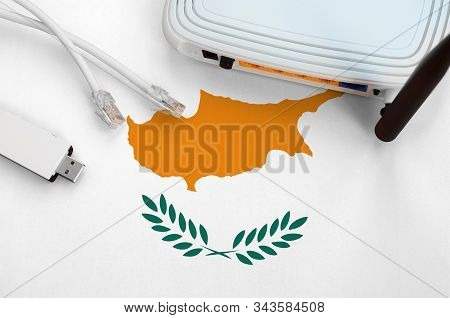 Cyprus Flag Depicted On Table With Internet Rj45 Cable, Wireless Usb Wifi Adapter And Router. Intern