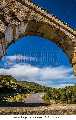 Roman Aqueduct Pont Du Gard Over Gardon River - Nimes, France, Europe