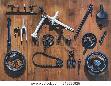 Bicycle Parts Lay On Wooden Wall Background Flat Lay Equipment Cycling Tools