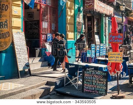 Buenos Aires, Argentina - July 25, 2014: Tango Dancers At La Boca District, Known For Its Vibrant Co
