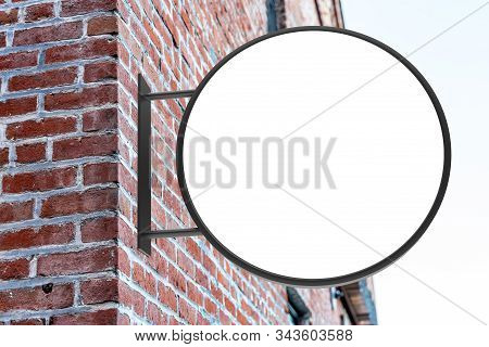 Round White Company Sign Mockup On A Brick Wall.