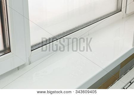 Plastic Window With Damp And Water Condensation On Glass. Bad Ventilation In House During Cold Weath