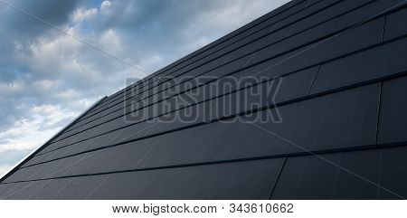 Black Solar Roof Concept. Building-integrated Photovoltaics System Consisting Of Modern Monocrystal