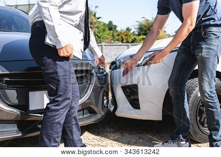 Insurance Agent Examining Car Crash And Customer Assessed Negotiation, Checking And Signing On Repor