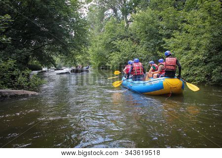 Tak / Thailand - November 9, 2019: A Group Of Tourists With A Guide Rafting Along The River Through
