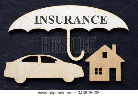 Comprehensive Car And Home Insurance. Wooden Umbrella And Models.