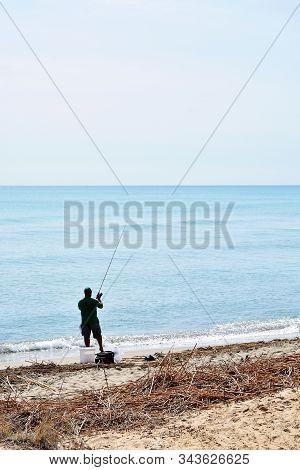 Man Fishing In The Gola Del Segura On The Segura River Of Guardamar Del Segura, Alicante. Spain. Eur