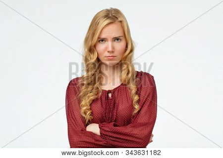 Girl With Blonde Long Hair Frowning Her Face In Displeasure