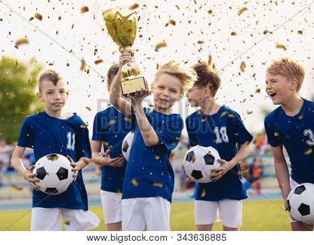 Happy Kids In Elementary School Sports Team Celebrating Soccer Succes In Tournament Final Game. Boys