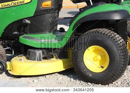 London,  Uk, May 13, 2019 - John Deer Lawn Mower Green Tool