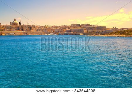 Malta, Sliema. Panoramic View Of Mediterannean Sea And Old Town Buildings, Colorful Bright Sky.