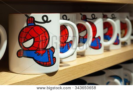 Minsk, Belarus - December 20, 2019: Ceramic Mugs On A Shelf In The Miniso Store With Images Of Spide