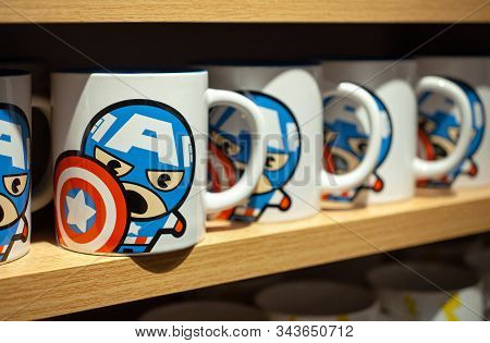 Minsk, Belarus - December 20, 2019: Ceramic Mugs On A Shelf In The Miniso Store With Images Of Capta