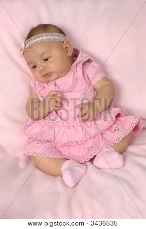 Cute 3-Month-Old Baby Girl In Pink