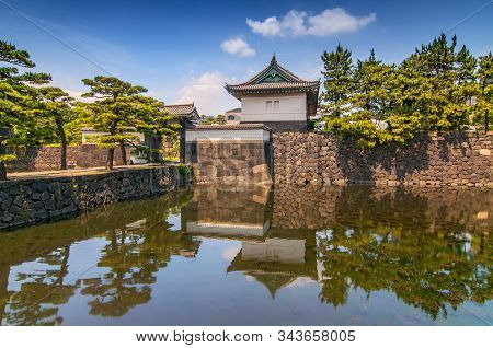Tokyo Imperal Palace And Its Reflection In The Water, Japan.