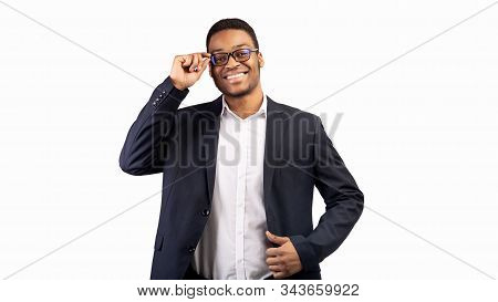 Business Concept. Portrait Of Smiling African American Ceo Company Leader In Eyewear Over White Back