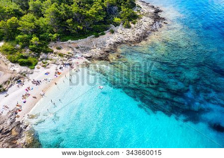 Aerial View On The Beach, Stones And Azure Sea. Beach And Sea From Air. Summer Seascape From Drone.