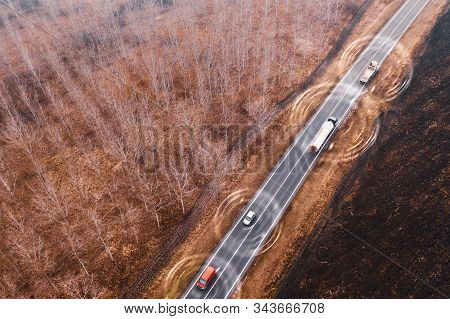 Aerial View Of Autonomous Self-driving Car On Road Through Countryside From Drone Pov, Conceptual Im