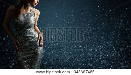 Silver Dress, Fashion Model Posing In Sparkling Sexy Gown, Woman Beauty Portrait On Lighting Sparkle
