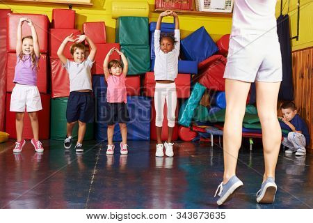 Happy group of kids together while kid sports in preschool