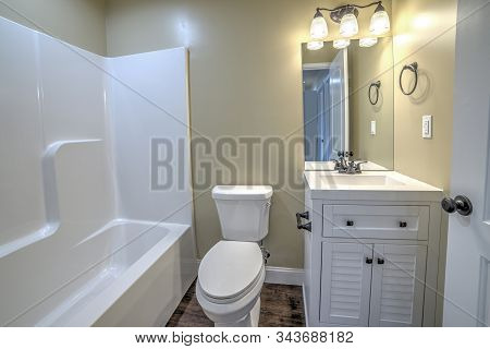 Horizontal Shot Of A Bathroom In A New Small Starter Home.