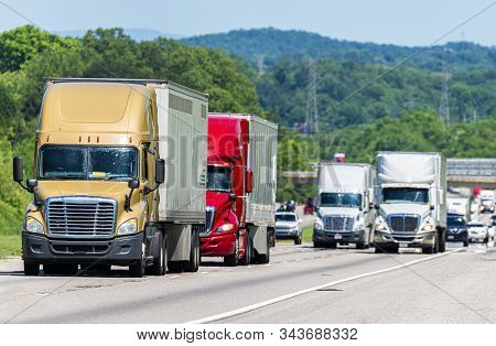 Horizontal Shot Of Busy Truck Traffic On An Interstate Highway.