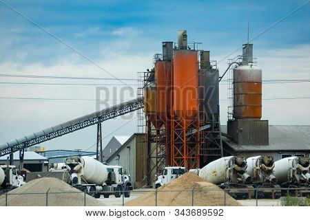A Wide Angle View Of A Concrete Batching And Manufacture Plant With Aggregate Conveyor, Cement Silos