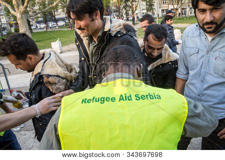 Belgrade, Serbia - April 2, 2016: Volunteer From The Ngo Refugee Aid Serbia Distributing Help And Fo