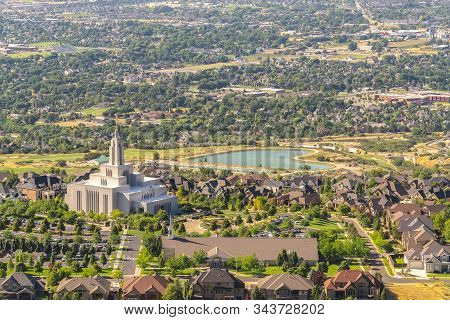 Temple And Geart Shaped Lake Amid Buildings And Houses In Salt Lake City Utah
