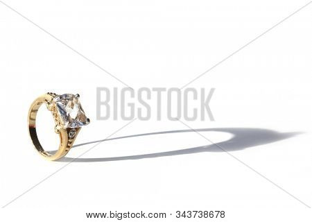 . Engagement Ring. Wedding Ring. Gold and Diamond Engagement or Wedding Ring on a White with Shadows. Isolated on White. Room for text. clipping path. Wedding Rings are enjoyed world