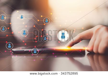 Woman Hand Using Smart Phone At Coffee Shop With People Icon And Line Dot Abstract Background. Techn