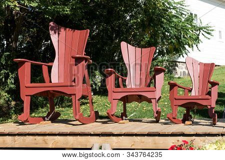 Three Traditional Adirondack Chairs In Different Sizes. Canada