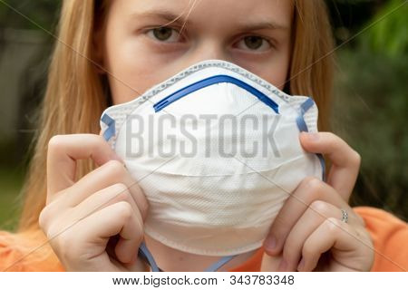 Australian Bushfire: Blond Girl Wearing P2 N95 Protection Respiratory Mask To Reduce Amount Of Breat