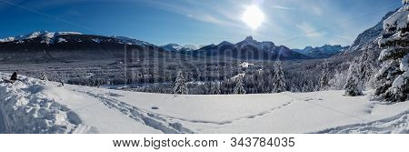 Banff, Canada - December 25, 2019 Panoramic View Of A Snowy Valley In Kananaskis, Banff, Alberta In