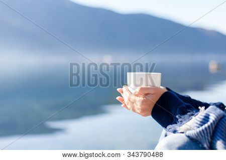 Winter Picnic. Woman Drinks Coffee At Sea Beach. Girl Enjoying Calm Nature, Traveling, Relaxation. B