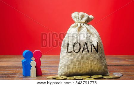Money Bag With The Word Loan And Family. The Concept Of Accumulation Of Money For The Payment Of Cre