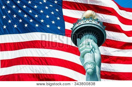 Statue Of Liberty Torch And Us Flag