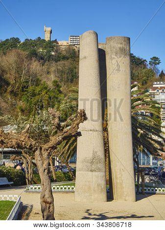 San Sebastian, Spain - January 1, 2020.the Zeharki Statue By Jose Ramon Anda With The Igueldo Tower