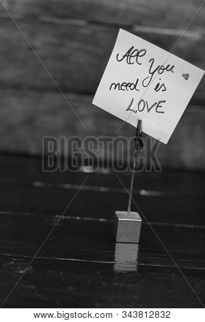 Square Memo Holder With Memo Post Reminder. Writing All You Need Is Love On Paper. Bucharest, Romani