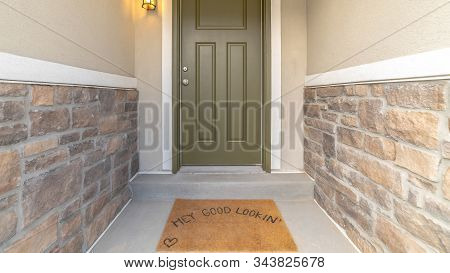 Pano Hey Good Looking Words On The Brown Doormat By The Front Door Of A Home