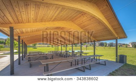 Pano Sunny Day Views At A Park With Pavilion And Basketball Court Under Blue Sky