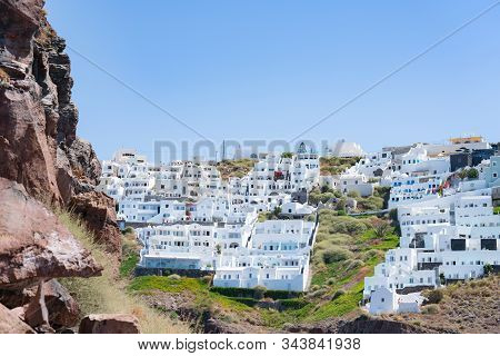 Santorini Greece - August 10 2019; View To White Homes And Hotels Of Fira From Skaros Rock A Rocky H