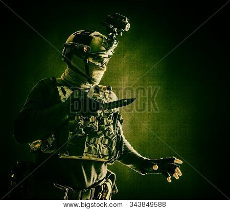 Commando Fighter Creeping In Darkness With Knife