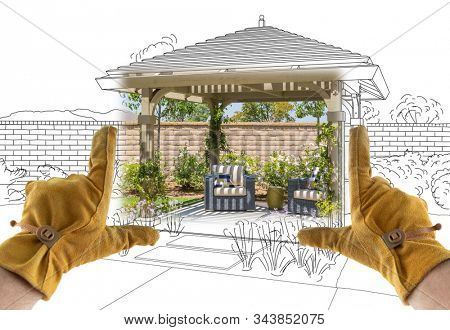 Male Contractor Hands Framing Completed Section of Custom Pergola Patio Cover Design Drawing.