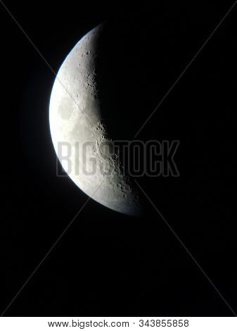 The Moon Through The Telescope At Night