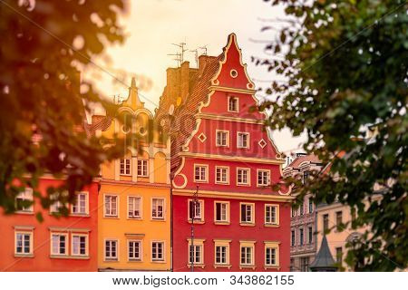 Wroclaw Old Town Houses In Poland, Europe. Sunset Sky In Background