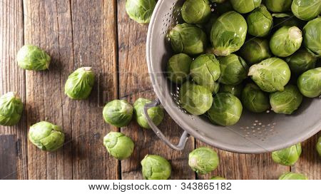 raw brussel sprouts on wood background