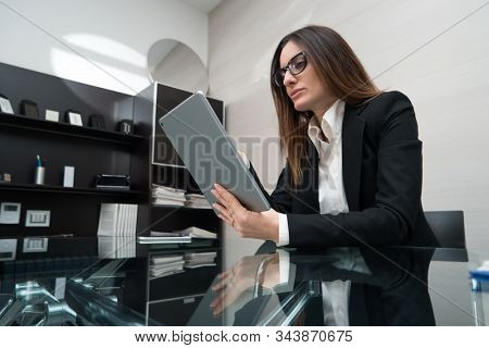 Business woman using a tablet in her modern office
