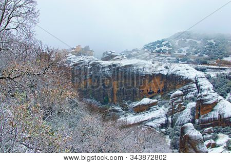 Dramatic Winter Landscape With Monastery Meteora The Top Of Mountain In Kalambaka, Greece. Light Sno