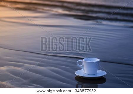 Coffee Cup On The Sea Sand On The Promenade.white Coffee Cup On Beach With Warm Sunlight .selective